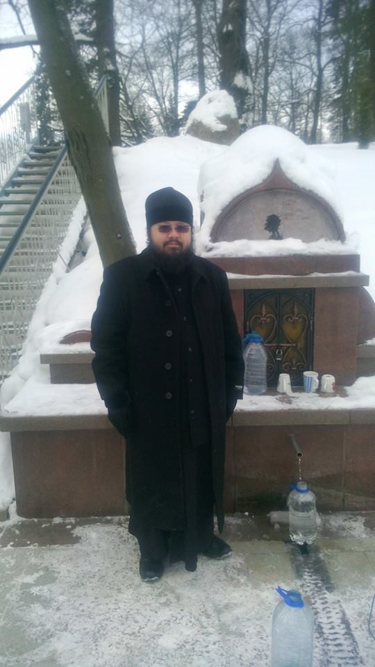 Father Philip drawing water in snowy Moscow, Russia