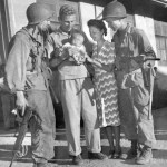 Mr. & Mrs. Hal Bowie and baby daughter Leah. Los Banos Interment Camp survivors, Laguna, Philippines 1945