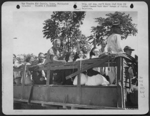 Newly liberated Los Baños-internees en route to New Bilibid Prison, February 1945