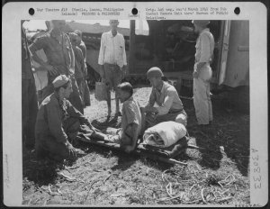 Wounded-Los-Banos-internee-being-evacuated-February-1945