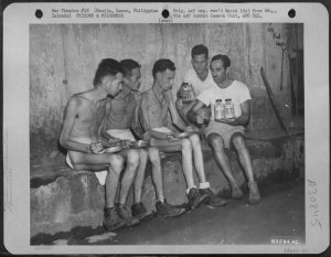 Three liberated POWs from Old Bilibid Prison being fed, February 1945