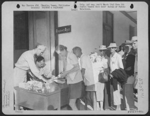 Liberated Los Banos internees being checked into New Bilibid 1945
