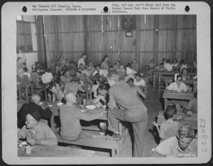 Liberated Los Banos internees being fed in meal hall a New Bilibid Prison, February 1945