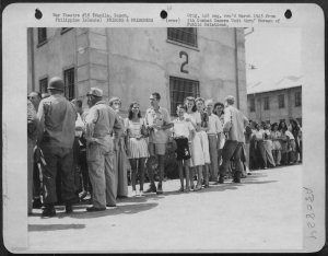 Liberated Los Banos internees lining up for meal at New Bilibid Prison, February1945