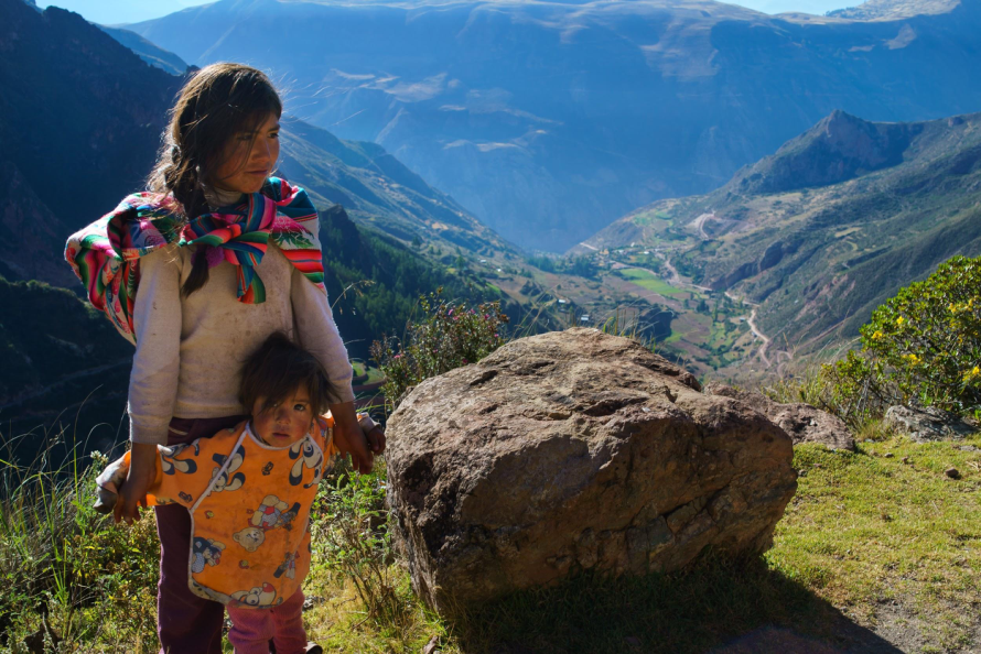 A nine-year-old girl walking with her sister through the mountains above the Sacred Valley stop to speak with us.