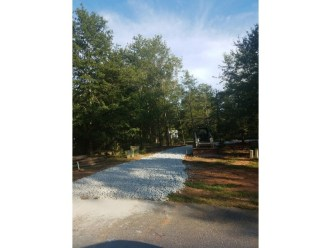 The gravel driveway leading to the site for the new home.