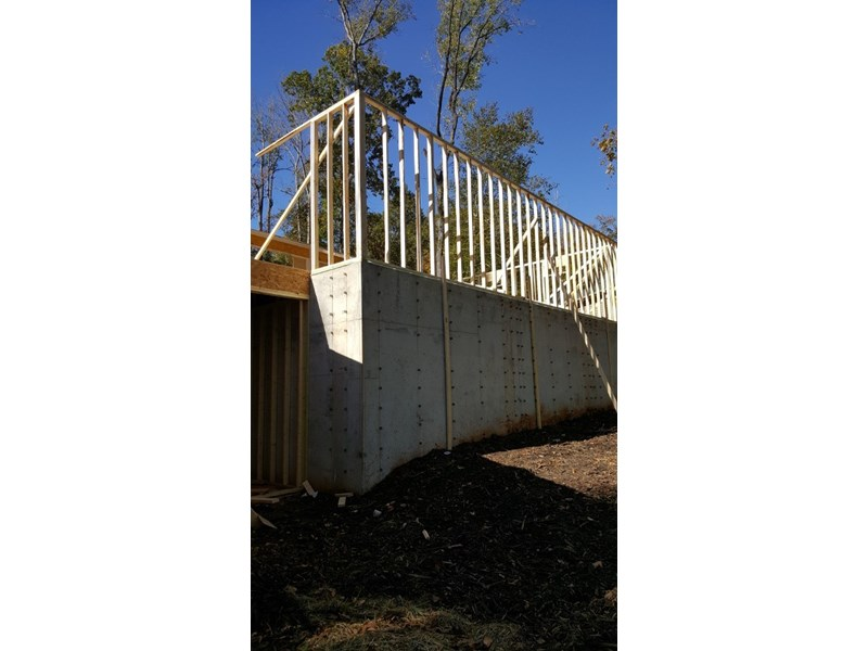 pored walls with framing above