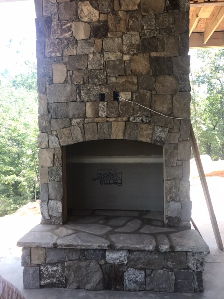 8-Screened-in porch fireplace getting stone