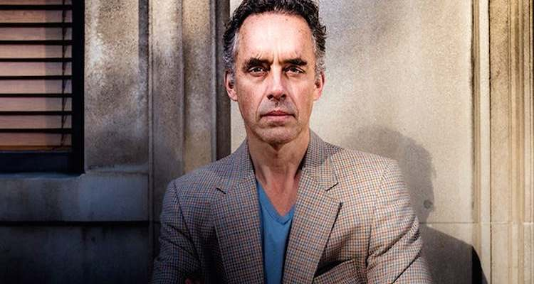 Professor Jordan B. Peterson standing against a wall