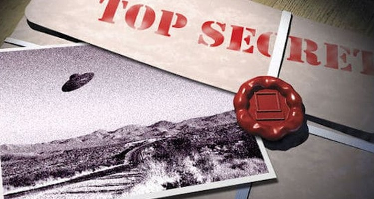 Top secret files with UFO photograph