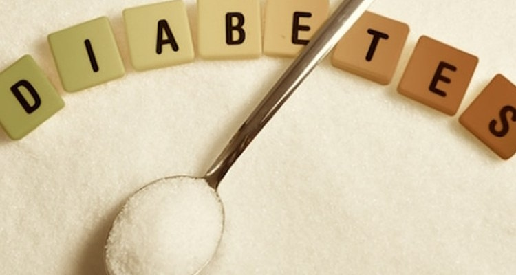 Diabetes spelled out with scrabbel pieces and spoonful of sugar