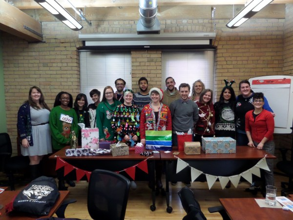 The cohort in all their ugly sweater glory!