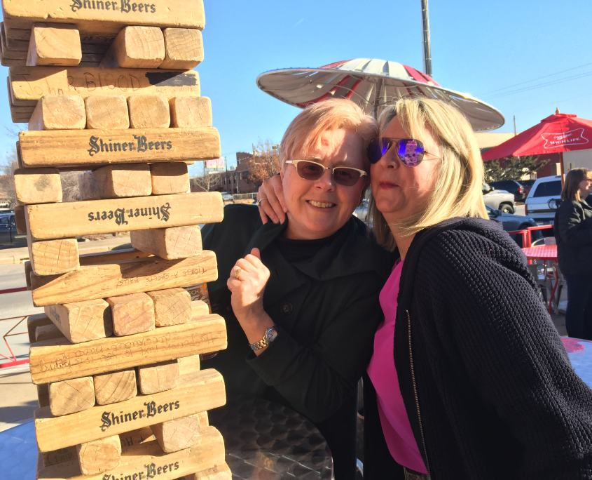 Directors Sally Hasenfratz and Nikki Edwards play Jenga at the after party.