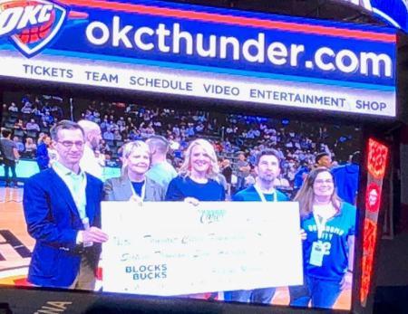 Oklahoma Law Firm Phillips Murrah presents Blocks for Bucks donation to OKC Thunder Cares Foundation