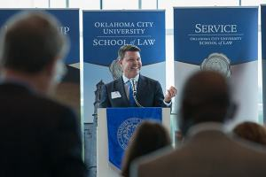 Jim Roth, Phillips Murrah Director and Oklahoma City University School of Law Dean, announces the revival of OCU Law's Alumni association at a meeting in early September.