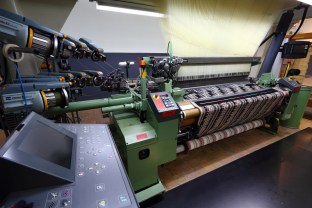The Textiellab employs a combination of Dornier looms and Staubli Jacquard heads. This particular machine looks capable of handling 12 different insertion threads.