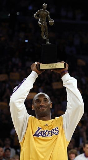 Kobe Bryant holding up the 2008 NBA MVP trophy,his next award would have been induction into the hall=of-fame.