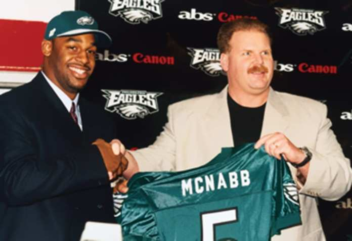 Andy Reid with Donovan McNabb after drafting him in the 1999 NFL draft