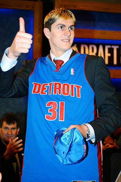 Darko Milicic gives a thumbs-up in his Pistons jersey.