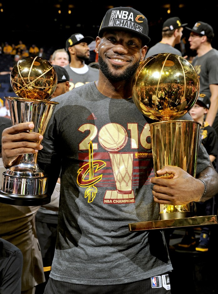 LeBron James celebrating winning the 2016 NBA championship with the Championship trophy and Finals MVP trophy