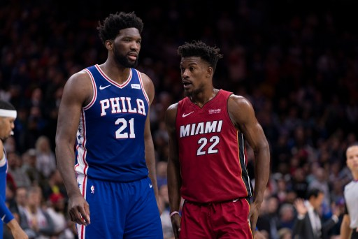 Joel Embiid and Jimmy Butler convering on the court, in 2019 the Sixers trade rumors were about Butler