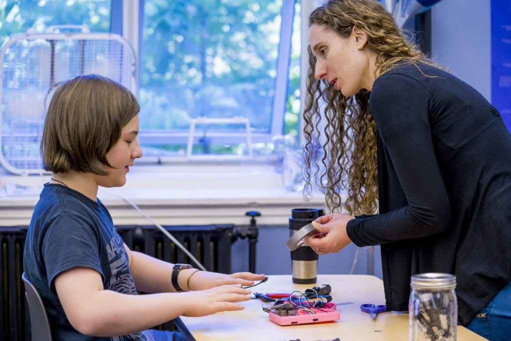 Lisa Shaffren works with a student at The Crefeld School's CrEF Lab