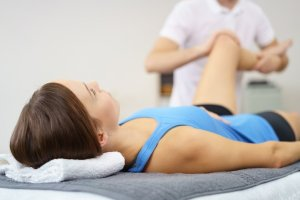 Leg physical rehabilitation therapy by a chiropractor