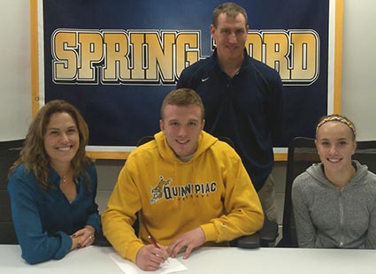 Jack Haney signs with Quinipiac, flanked by Helene Calci (left) and sister Michaela Haney, signs a national letter of intent to accept a Division I lacrosse scholarship from Quinnipiac University in Hamden, CT., during a recent signing ceremony at the high school. Also on hand for the signing was Spring-Ford head boys lacrosse coach Kevin Donnelly (standing).