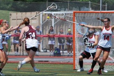 Fallon Quinn shoots on goal with Alex Laddy (14) defending (Photo for Phillylacrosse.com)