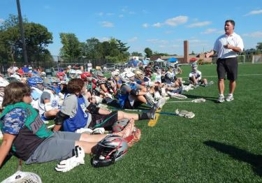 Episcopal Academy coach Chris Bates addresses the players at the Duke's L.C.'s Ricky Whelan Clinic Sunday at Shipley