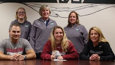 Addie Borkowski signs NLI: Pictured from left (standing) are Catie Sobotor (Coach), Laurie Markle (Head Coach), Casey Leap (Coach), Seated from left- Jeff Borkowski (Father), Addie Borkowski, Janell Borkowski (Mother)Position: Midfield/Attack