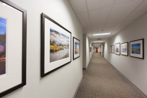 hallway with framed photographs