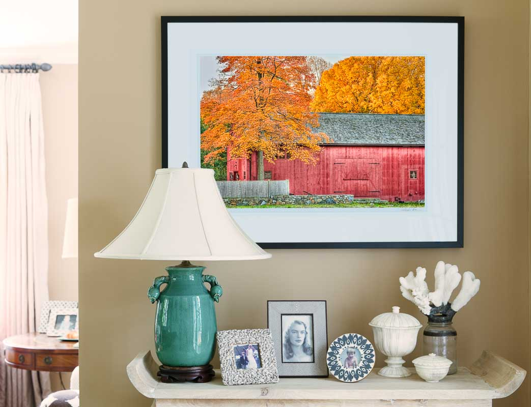 framed picture of barn on living room wall
