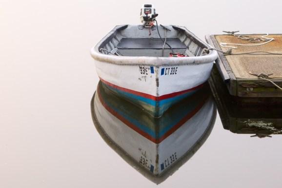 Motor Boat tied at Dock
