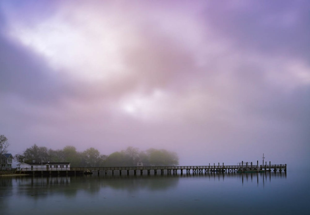 cloudy sunrise over the pier at nearwater lane