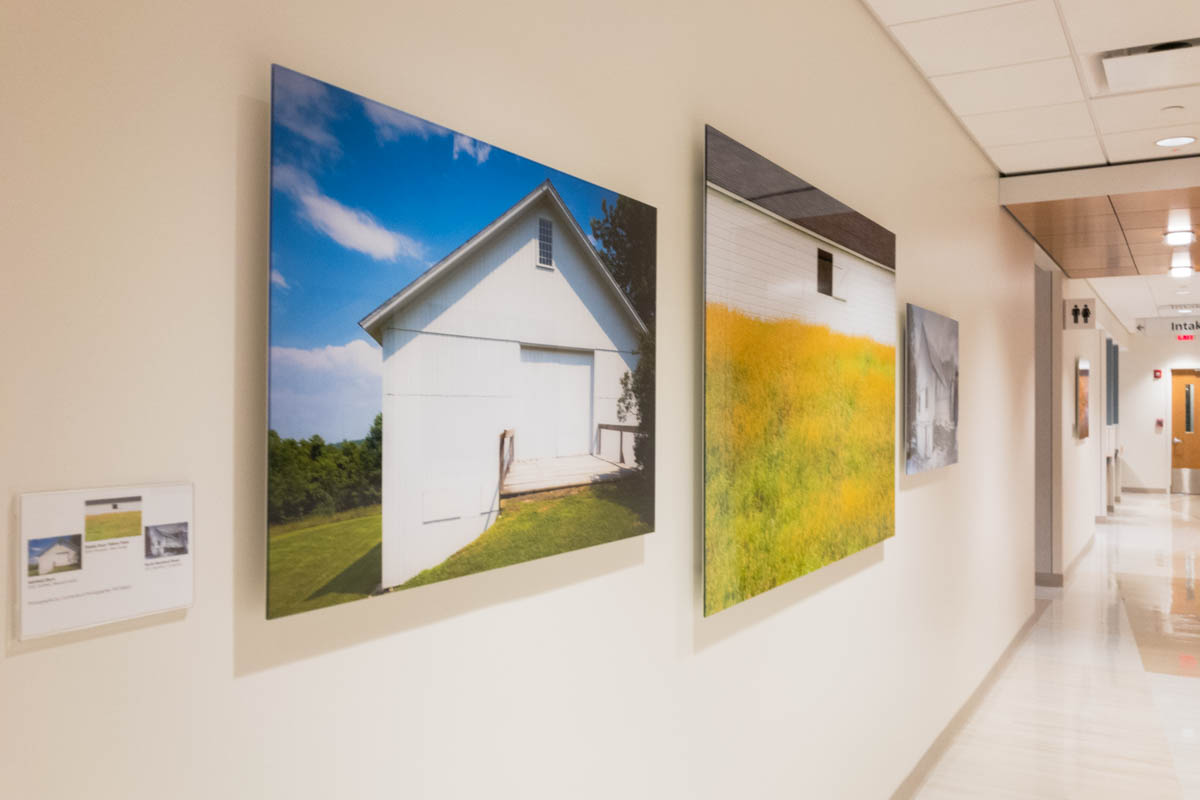 long hallway with three acrylic face mounted prints in the foreground
