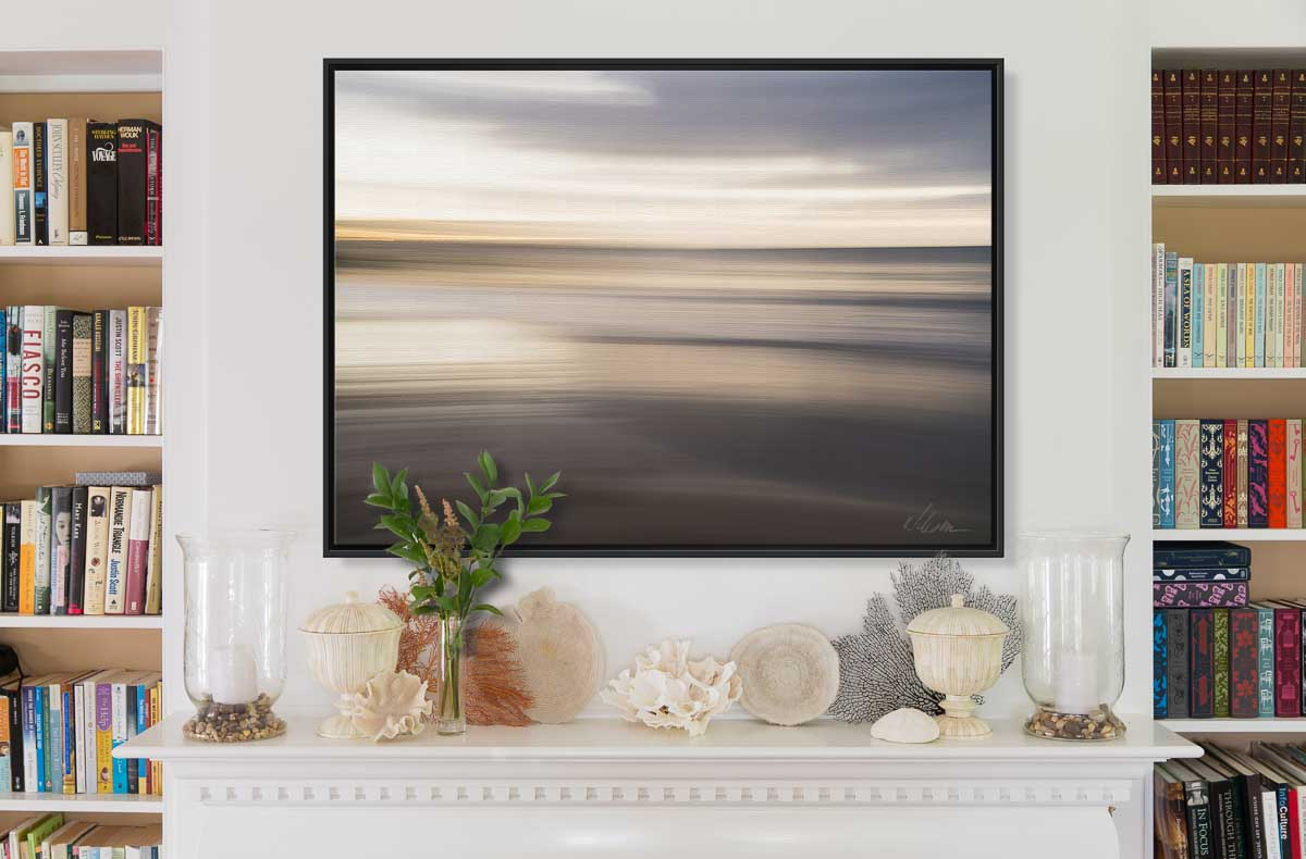 large canvas abstract print with float frame over mantle in living room