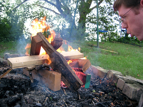 This fire has good coals and embers, and a fresh load of fuel. The wind will help, not hinder.