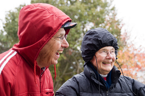 Seriously? Don't these people know it's raining? Their love of laughter and each-other's company seems to have freed them of the weight and pain of life.
