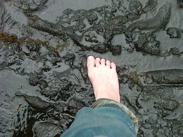 That's not a sand beach, it's cold hard (and sharp) lava flow. Barefoot?