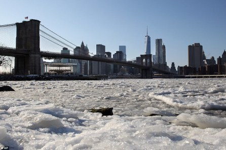25B850DC00000578-2955250-Frozen_over_The_East_River_in_New_York_was_clogged_with_massive_-a-23_1424091617667