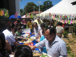 The crowd enjoying the fiesta- like community lunch.