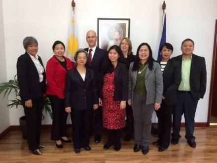 Ambassador Belen Anota, Consul Felix and wife Di Pintado (back) with Philippine Embassy staff.