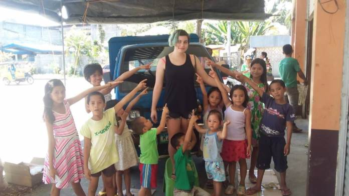The kids with volunteer Samantha Galea