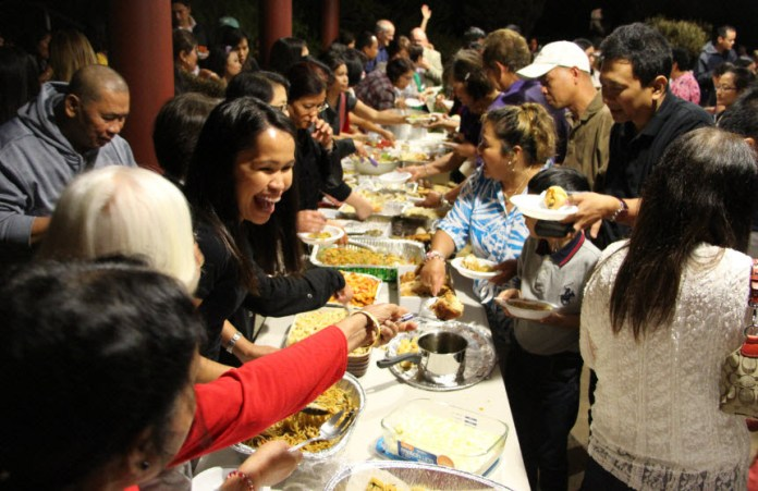 RFA photo: A previous social gathering and Filipino food extravaganza at St Monica's Parish after the completion of one of the Simbang Gabi masses at 9pm in 2016.
