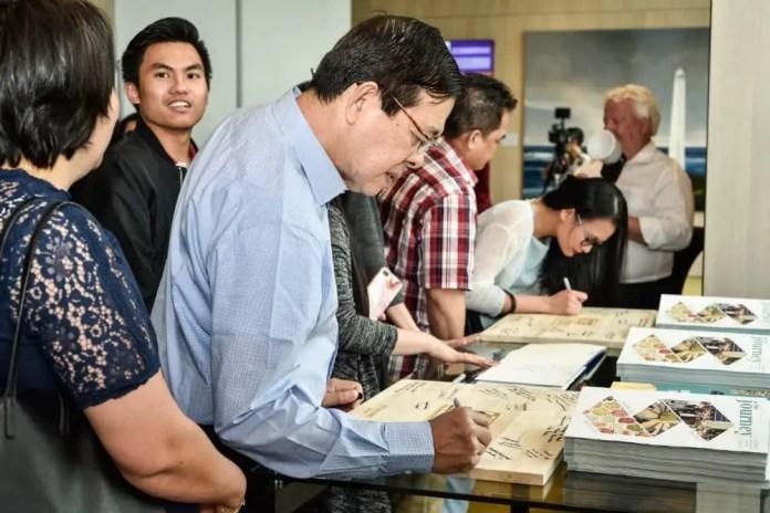 Guests sign La Naval's 20h Anniversary souvenir board