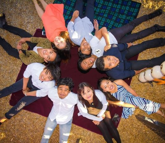 Family photo: Raine (striped blue dress), Marian Cabral (mother), Kenneth Joshua, Keiser Lance, Karol John, Kim Gail, Kristoff James, Kurt Leighton and Michael Laysico.   Photo by Valsite Imprints Photography and Films