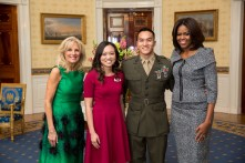 First Lady Michelle Obama and Dr. Jill Biden greet Kathy Pham, First Lady's State of the Union box guest, and brother Captain David Pham in the Blue Room of the White House, Jan. 20, 2015. (Official White House Photo by Lawrence Jackson)