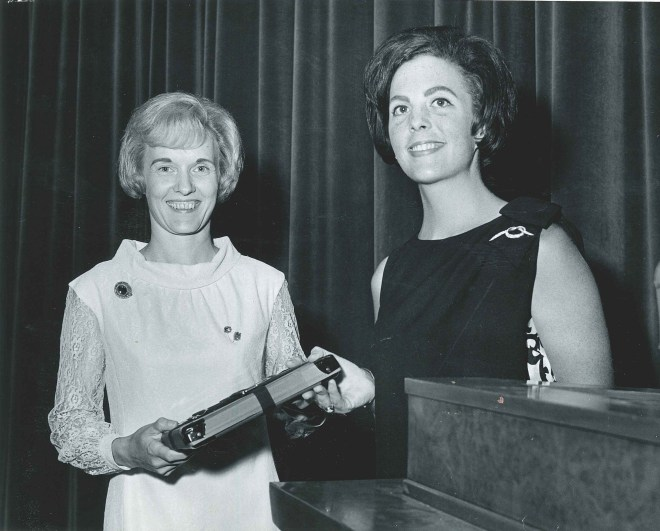 Annadell receives copy of the Phi Mu movie at Purdue University in 1967 from collaborator on script Yolande Branham.