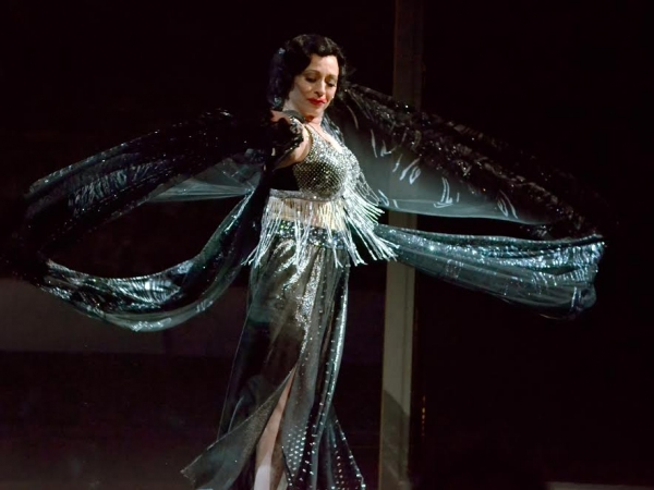 Ann Crumb, dressed like an exotic bird, ready to take off in her final scene in Sunset Boulevard at the Media Theatre. Photo by Mark Jordan.